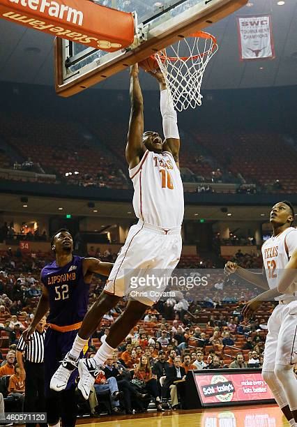Jonathan Holmes of the Texas Longhorns slam dunks against the Lipscomb Bisons at the Frank Erwin Center on December 16 2014 in Austin Texas