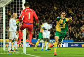 Jonathan Howson of Norwich City celebrates scoring his team's first goal during the Barclays Premier League match between Norwich City and Swansea...
