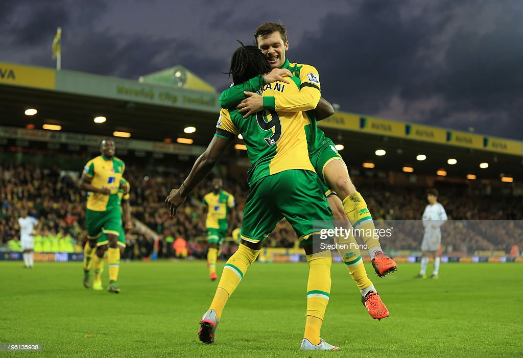 Jonathan Howson (R) of Norwich City celebrates scoring his team's first goal with his team mate <a gi-track='captionPersonalityLinkClicked' href=/galleries/search?phrase=Dieumerci+Mbokani&family=editorial&specificpeople=4528520 ng-click='$event.stopPropagation()'>Dieumerci Mbokani</a> (L) during the Barclays Premier League match between Norwich City and Swansea City at Carrow Road on November 7, 2015 in Norwich, England.