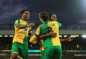 Jonathan Howson of Norwich City celebrates scoring his team's first goal with his team mate Dieumerci Mbokani and Alexander Tettey during the...