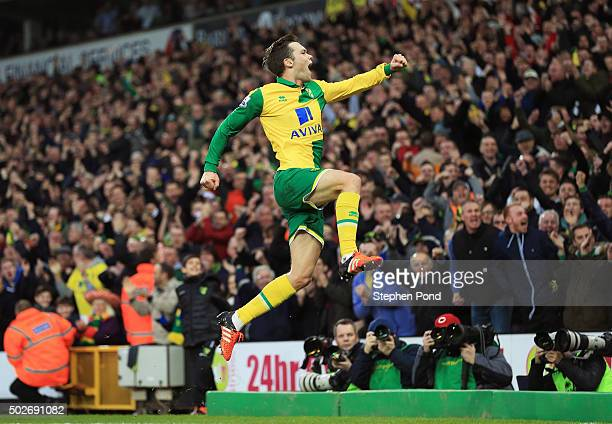 Jonathan Howson of Norwich City celebrates scoring his team's first goal during the Barclays Premier League match between Norwich City and Aston...
