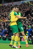 Jonathan Howson of Norwich City celebrates scoring his team's first goal with his team mate Russel Martin during the Barclays Premier League match...