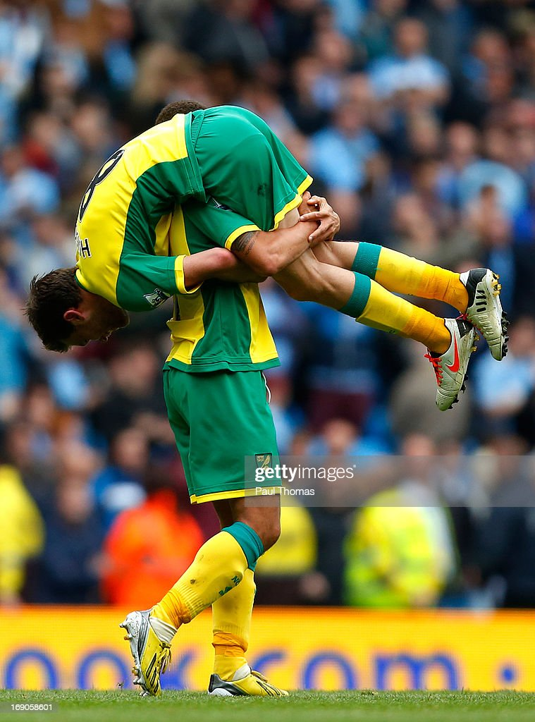 Jonathan Howson of Norwich is carried by team mate Elliott Bennett at full time of the Barclays Premier League match between Manchester City and Norwich City at the Etihad Stadium on May 19, 2013 in Manchester, England.