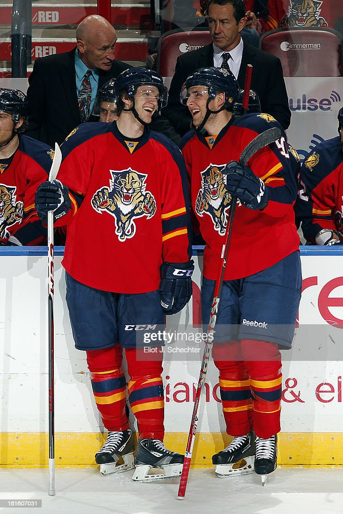 Jonathan Huberdeau #11 of the Florida Panthers and teammate Drew Shore #50 smile and chat after both scoring goals against the Washington Capitals at the BB&T Center on February 12, 2013 in Sunrise, Florida.