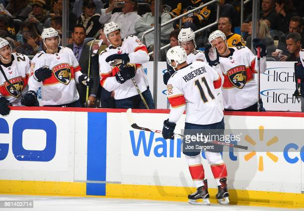 Jonathan Huberdeau of the Florida Panthers celebrate his second period goal against the Pittsburgh Penguins at PPG Paints Arena on October 14 2017 in...