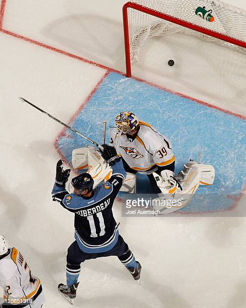 Jonathan Huberdeau of the Florida Panthers celebrates after scoring a goal against Anders Lindback of the Nashville Predators on September 19 2011 at...