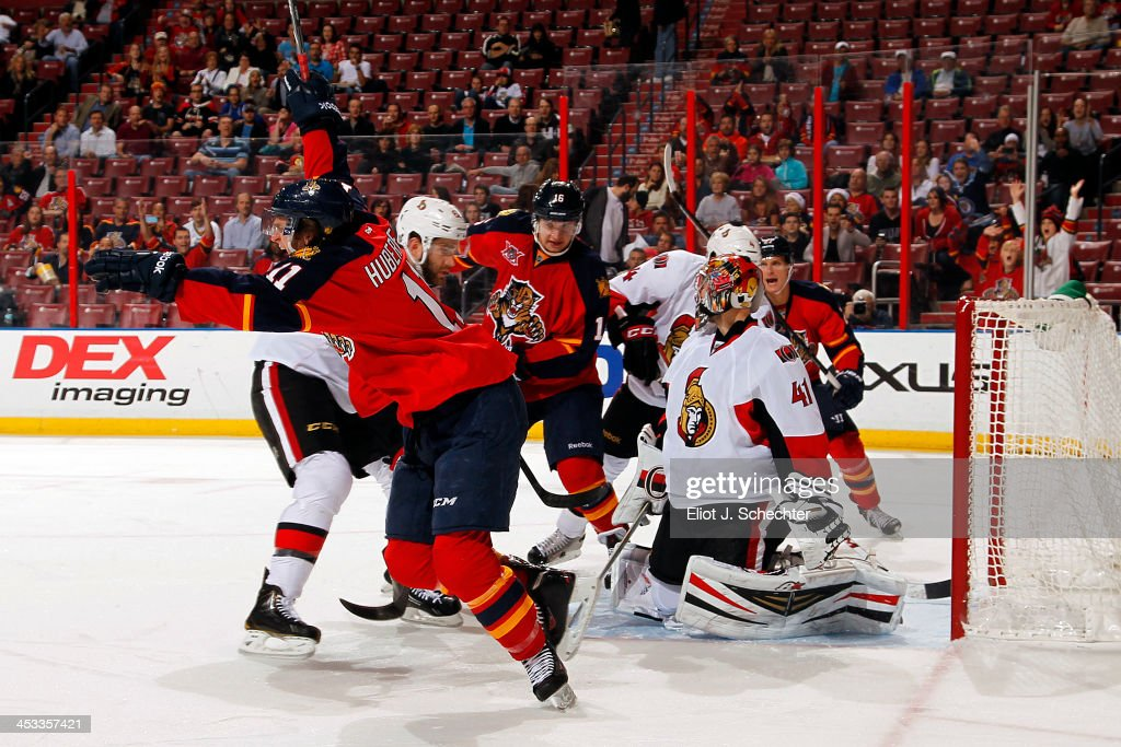 <a gi-track='captionPersonalityLinkClicked' href=/galleries/search?phrase=Jonathan+Huberdeau&family=editorial&specificpeople=7144196 ng-click='$event.stopPropagation()'>Jonathan Huberdeau</a> #11 of the Florida Panthers celebrates his goal against the Ottawa Senators at the BB&T Center on December 3, 2013 in Sunrise, Florida.