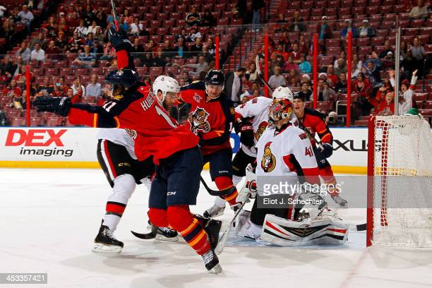Jonathan Huberdeau of the Florida Panthers celebrates his goal against the Ottawa Senators at the BBT Center on December 3 2013 in Sunrise Florida