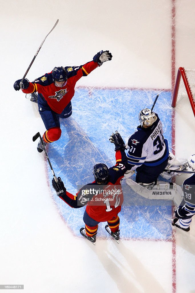 <a gi-track='captionPersonalityLinkClicked' href=/galleries/search?phrase=Jonathan+Huberdeau&family=editorial&specificpeople=7144196 ng-click='$event.stopPropagation()'>Jonathan Huberdeau</a> #11 of the Florida Panthers celebrates his goal with teammate <a gi-track='captionPersonalityLinkClicked' href=/galleries/search?phrase=Jack+Skille&family=editorial&specificpeople=697014 ng-click='$event.stopPropagation()'>Jack Skille</a> #12 against the Winnipeg Jets at the BB&T Center on January 31, 2013 in Sunrise, Florida.