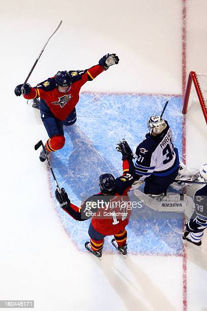 Jonathan Huberdeau of the Florida Panthers celebrates his goal with teammate Jack Skille against the Winnipeg Jets at the BBT Center on January 31...