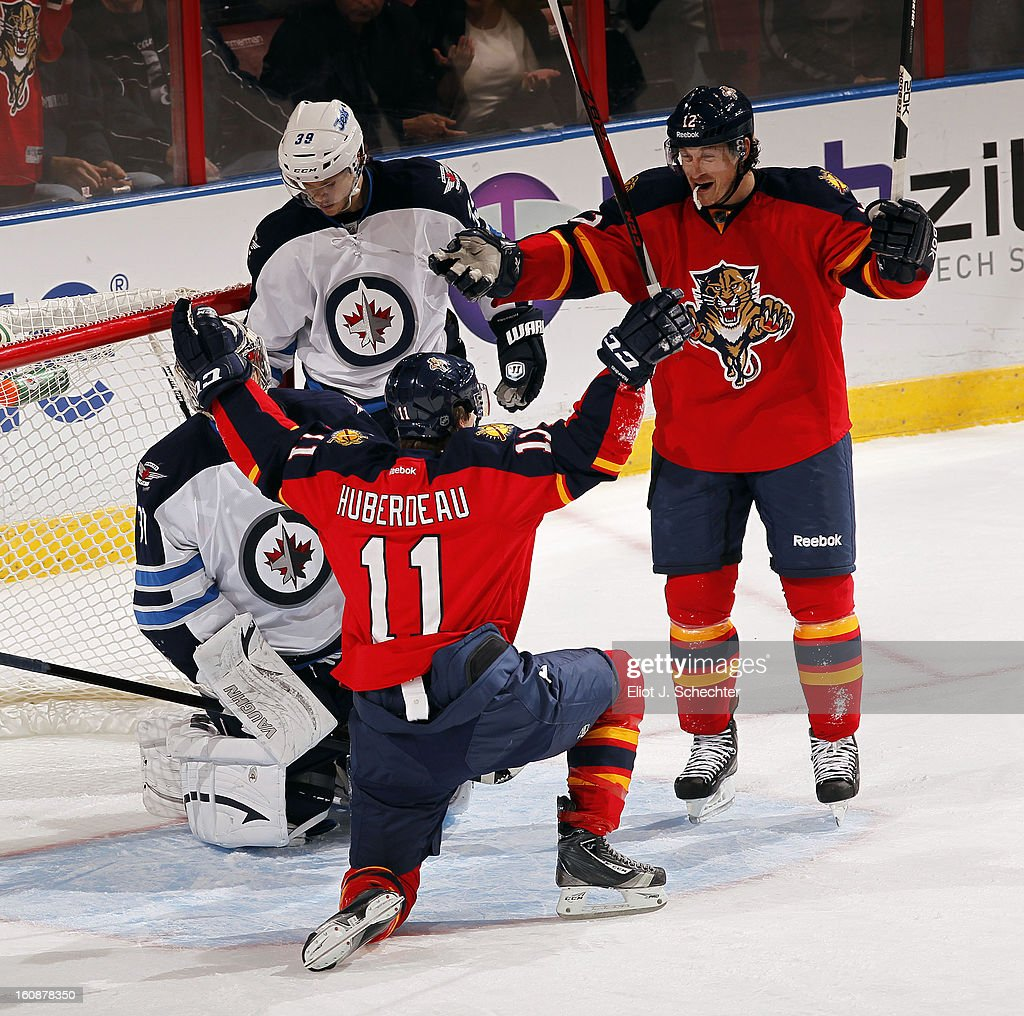 Jonathan Huberdeau #11 of the Florida Panthers celebrates his goal with teammate Jack Skille #12 against the Winnipeg Jets at the BB&T Center on January 31, 2013 in Sunrise, Florida.