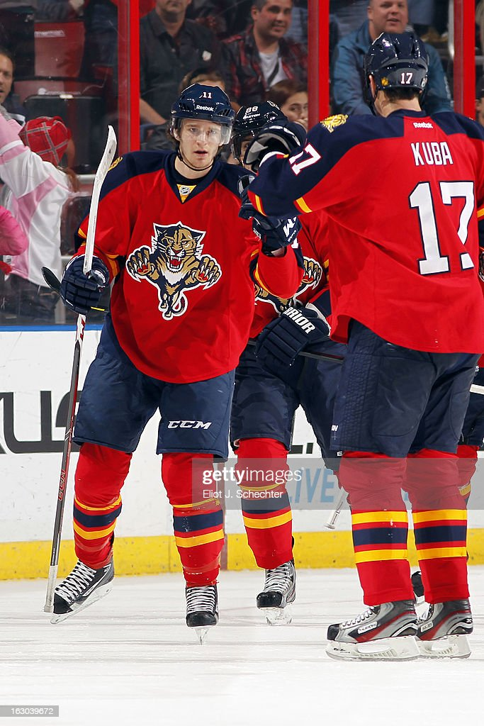 <a gi-track='captionPersonalityLinkClicked' href=/galleries/search?phrase=Jonathan+Huberdeau&family=editorial&specificpeople=7144196 ng-click='$event.stopPropagation()'>Jonathan Huberdeau</a> #11 of the Florida Panthers celebrates his goal with teammates against the Carolina Hurricanes at the BB&T Center on March 3, 2013 in Sunrise, Florida.