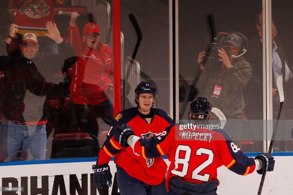 <a gi-track='captionPersonalityLinkClicked' href=/galleries/search?phrase=Jonathan+Huberdeau&family=editorial&specificpeople=7144196 ng-click='$event.stopPropagation()'>Jonathan Huberdeau</a> #11 of the Florida Panthers celebrates his goal with teammate <a gi-track='captionPersonalityLinkClicked' href=/galleries/search?phrase=Tomas+Kopecky&family=editorial&specificpeople=2234349 ng-click='$event.stopPropagation()'>Tomas Kopecky</a> #82 against the Carolina Hurricanes at the BB&T Center on March 3, 2013 in Sunrise, Florida.