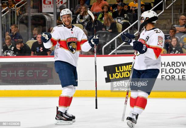 Jonathan Huberdeau of the Florida Panthers celebrates his second period goal against the Pittsburgh Penguins at PPG Paints Arena on October 14 2017...
