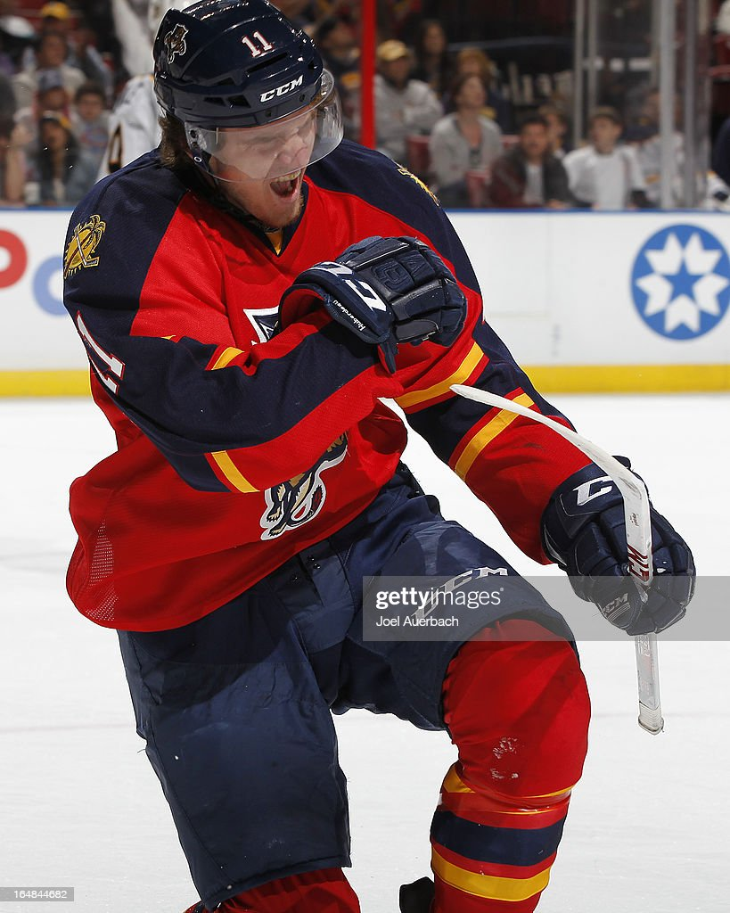 <a gi-track='captionPersonalityLinkClicked' href=/galleries/search?phrase=Jonathan+Huberdeau&family=editorial&specificpeople=7144196 ng-click='$event.stopPropagation()'>Jonathan Huberdeau</a> #11 of the Florida Panthers celebrates his third period goal to tie the game against the Buffalo Sabres at the BB&T Center on March 28, 2013 in Sunrise, Florida. The Panthers defeated the Sabres 5-4 in a shoot out.
