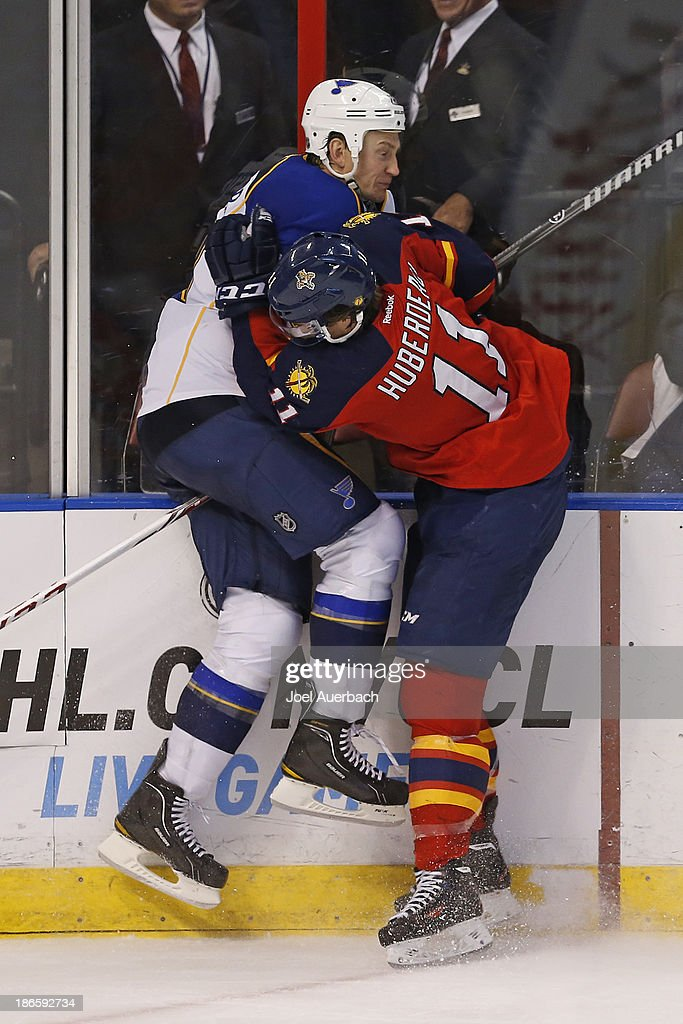 <a gi-track='captionPersonalityLinkClicked' href=/galleries/search?phrase=Jonathan+Huberdeau&family=editorial&specificpeople=7144196 ng-click='$event.stopPropagation()'>Jonathan Huberdeau</a> #11 of the Florida Panthers checks <a gi-track='captionPersonalityLinkClicked' href=/galleries/search?phrase=Jay+Bouwmeester&family=editorial&specificpeople=201875 ng-click='$event.stopPropagation()'>Jay Bouwmeester</a> #19 of the St. Louis Blues during third period action at the BB&T Center on November 1, 2013 in Sunrise, Florida. The Blues defeated the Panthers 4-0.
