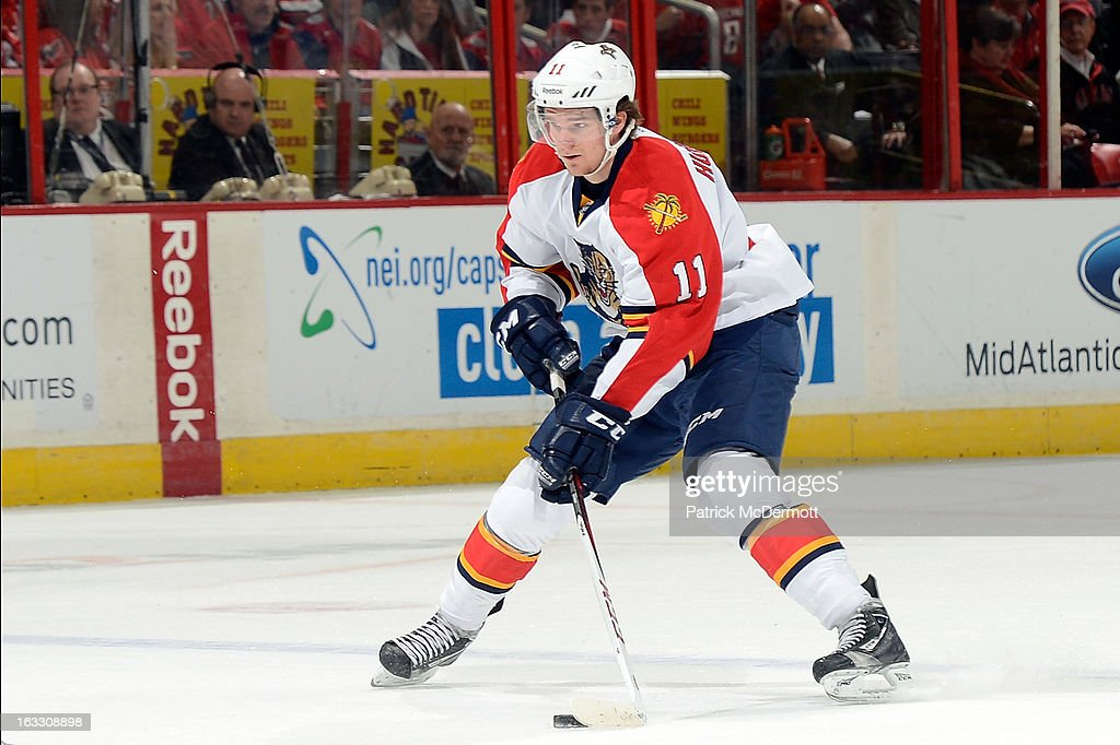 <a gi-track='captionPersonalityLinkClicked' href=/galleries/search?phrase=Jonathan+Huberdeau&family=editorial&specificpeople=7144196 ng-click='$event.stopPropagation()'>Jonathan Huberdeau</a> #11 of the Florida Panthers controls the puck during an NHL game against Washington Capitals at Verizon Center on March 7, 2013 in Washington, DC.