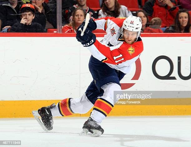 Jonathan Huberdeau of the Florida Panthers fires a slapshot during an NHL game against the Carolina Hurricanes at PNC Arena on February 7 2014 in...