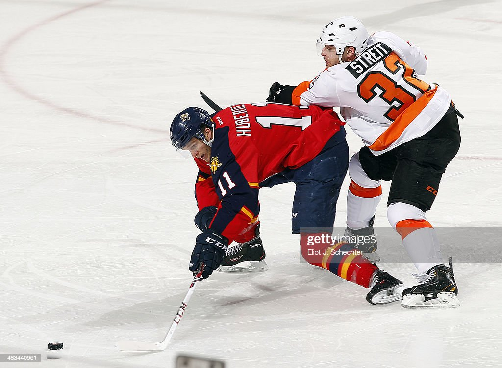 <a gi-track='captionPersonalityLinkClicked' href=/galleries/search?phrase=Jonathan+Huberdeau&family=editorial&specificpeople=7144196 ng-click='$event.stopPropagation()'>Jonathan Huberdeau</a> #11 of the Florida Panthers gathers the puck than scores against <a gi-track='captionPersonalityLinkClicked' href=/galleries/search?phrase=Mark+Streit&family=editorial&specificpeople=636976 ng-click='$event.stopPropagation()'>Mark Streit</a> #32 of the Philadelphia Flyers at the BB&T Center on April 8, 2014 in Sunrise, Florida.