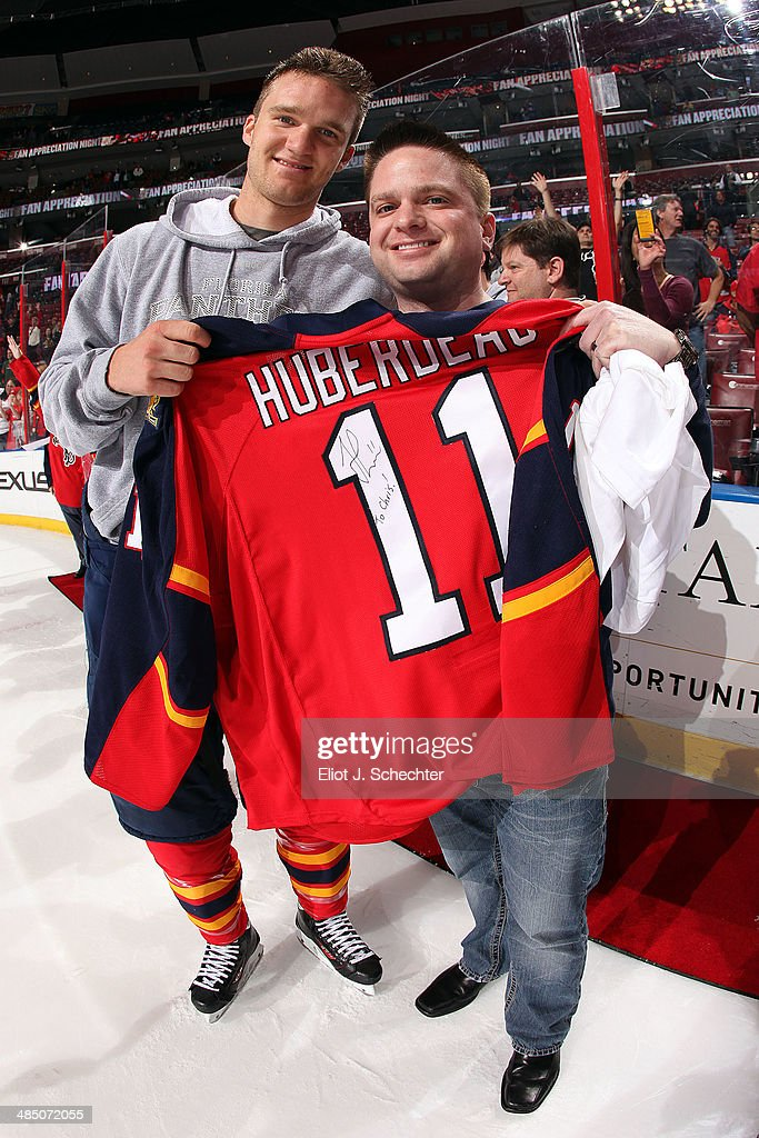 Jonathan Huberdeau #11 of the Florida Panthers gives the jersey off his back to a fan after the final game of the season against the Columbus Blue Jackets at the BB&T Center on April 12, 2014 in Sunrise, Florida.