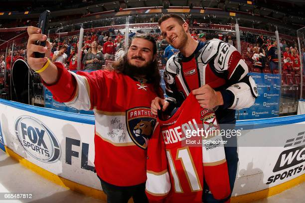 Jonathan Huberdeau of the Florida Panthers gives the jersey off his back to a fan after their game against the St Louis Blues at the BBT Center on...