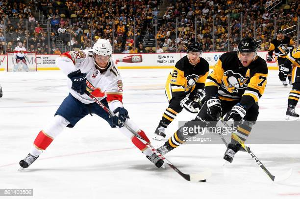 Jonathan Huberdeau of the Florida Panthers handles the puck against Evgeni Malkin of the Pittsburgh Penguins at PPG Paints Arena on October 14 2017...