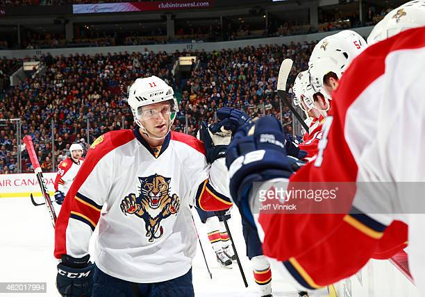 Jonathan Huberdeau of the Florida Panthers is congratulated by teammates after scoring during their NHL game against the Vancouver Canucks at Rogers...
