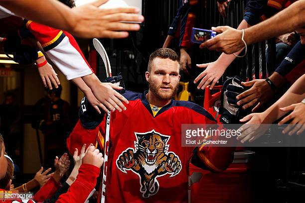 Jonathan Huberdeau of the Florida Panthers is greeted by fans while heading out to the ice prior to the start of the game against the Carolina...