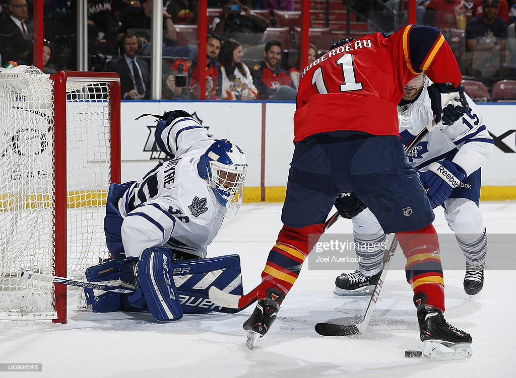 <a gi-track='captionPersonalityLinkClicked' href=/galleries/search?phrase=Jonathan+Huberdeau&family=editorial&specificpeople=7144196 ng-click='$event.stopPropagation()'>Jonathan Huberdeau</a> #11 of the Florida Panthers is unable to gain control of the puck on a rebound by goaltender Drew MacIntyre #35 of the Toronto Maple Leafs at the BB&T Center on April 10, 2014 in Sunrise, Florida. The Panthers defeated the Maple Leafs 4-2.