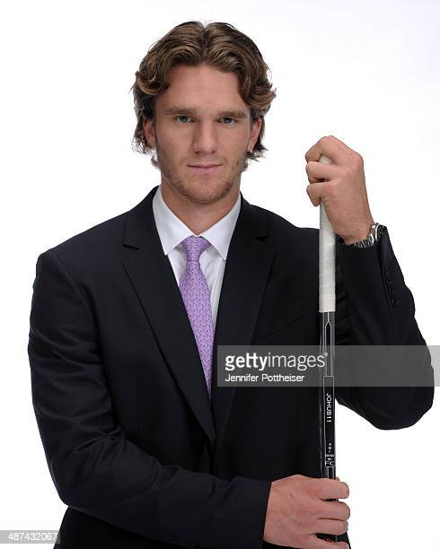 Jonathan Huberdeau of the Florida Panthers poses in apparel for the National Hockey League's Hockey Fights Cancer Initiative during the NHL Player...