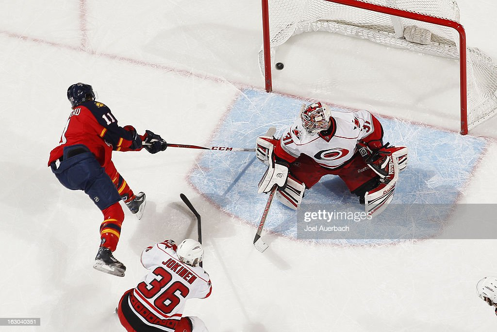 Jonathan Huberdeau #11 of the Florida Panthers scores a second period goal against Goaltender Dan Ellis #31 of the Carolina Hurricanes at the BB&T Center on March 3, 2013 in Sunrise, Florida. The Hurricanes defeated the Panthers 3-2.