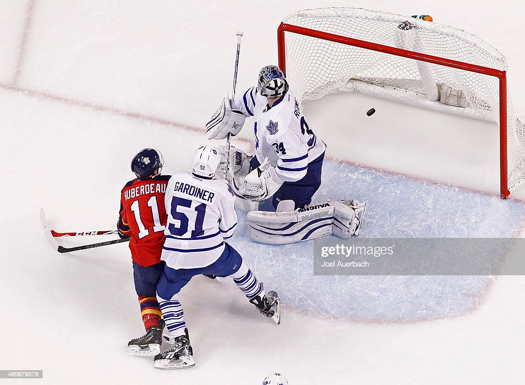<a gi-track='captionPersonalityLinkClicked' href=/galleries/search?phrase=Jonathan+Huberdeau&family=editorial&specificpeople=7144196 ng-click='$event.stopPropagation()'>Jonathan Huberdeau</a> #11 of the Florida Panthers scores a second period goal past Goaltender <a gi-track='captionPersonalityLinkClicked' href=/galleries/search?phrase=James+Reimer+-+Hockey&family=editorial&specificpeople=7543302 ng-click='$event.stopPropagation()'>James Reimer</a> #34 the Toronto Maple Leafs at the BB&T Center on December 28, 2014 in Sunrise, Florida. The Panthers defeated the Maple Leafs 6-4.