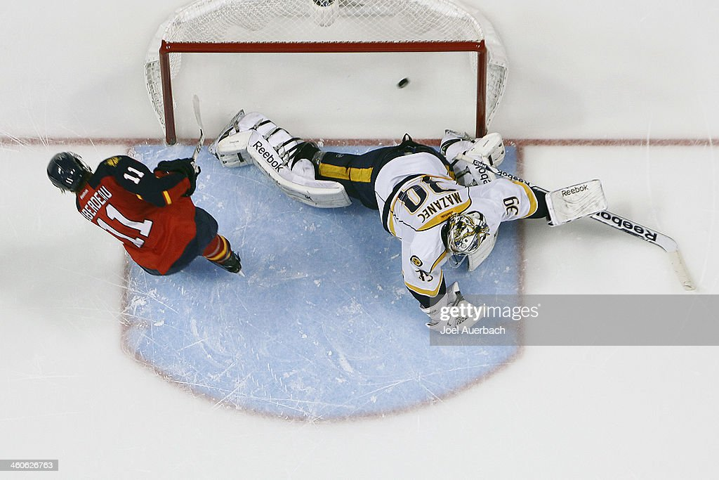 <a gi-track='captionPersonalityLinkClicked' href=/galleries/search?phrase=Jonathan+Huberdeau&family=editorial&specificpeople=7144196 ng-click='$event.stopPropagation()'>Jonathan Huberdeau</a> #11 of the Florida Panthers scores a shootout goal past goaltender Marek Mazanec #39 of the Nashville Predators at the BB&T Center on January 4, 2014 in Sunrise, Florida. The Panthers defeated the Predators 5-4 in a shootout.