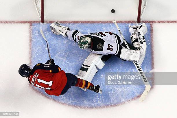 Jonathan Huberdeau of the Florida Panthers scores against goaltender Josh Harding of the Minnesota Wild in a shootout at the BBT Center on October 19...