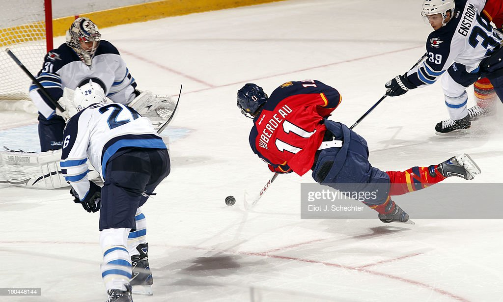 <a gi-track='captionPersonalityLinkClicked' href=/galleries/search?phrase=Jonathan+Huberdeau&family=editorial&specificpeople=7144196 ng-click='$event.stopPropagation()'>Jonathan Huberdeau</a> #11 of the Florida Panthers shoots and scores against Goaltender Ondrej Pavelec #31of the Winnipeg Jets at the BB&T Center on January 31, 2013 in Sunrise, Florida.