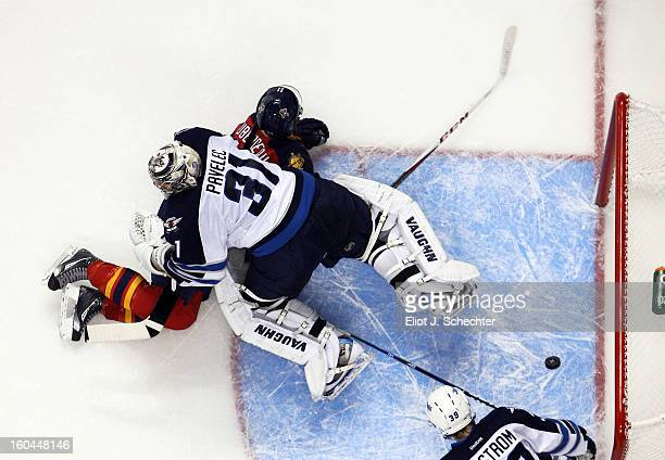 Jonathan Huberdeau of the Florida Panthers shoots and scores against Goaltender Ondrej Pavelec the Winnipeg Jets at the BBT Center on January 31 2013...