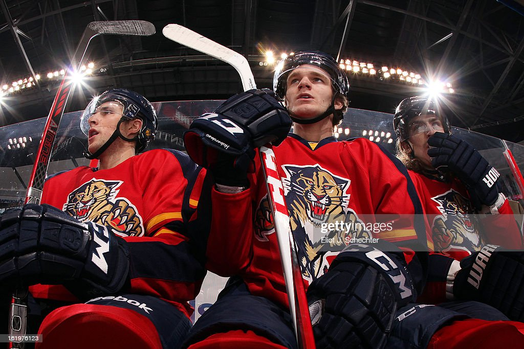 Jonathan Huberdeau #11 of the Florida Panthers sits on the bench between teammates Drew Shore #50 and Peter Mueller #88 against the Tampa Bay Lightning at the BB&T Center on February 16, 2013 in Sunrise, Florida.