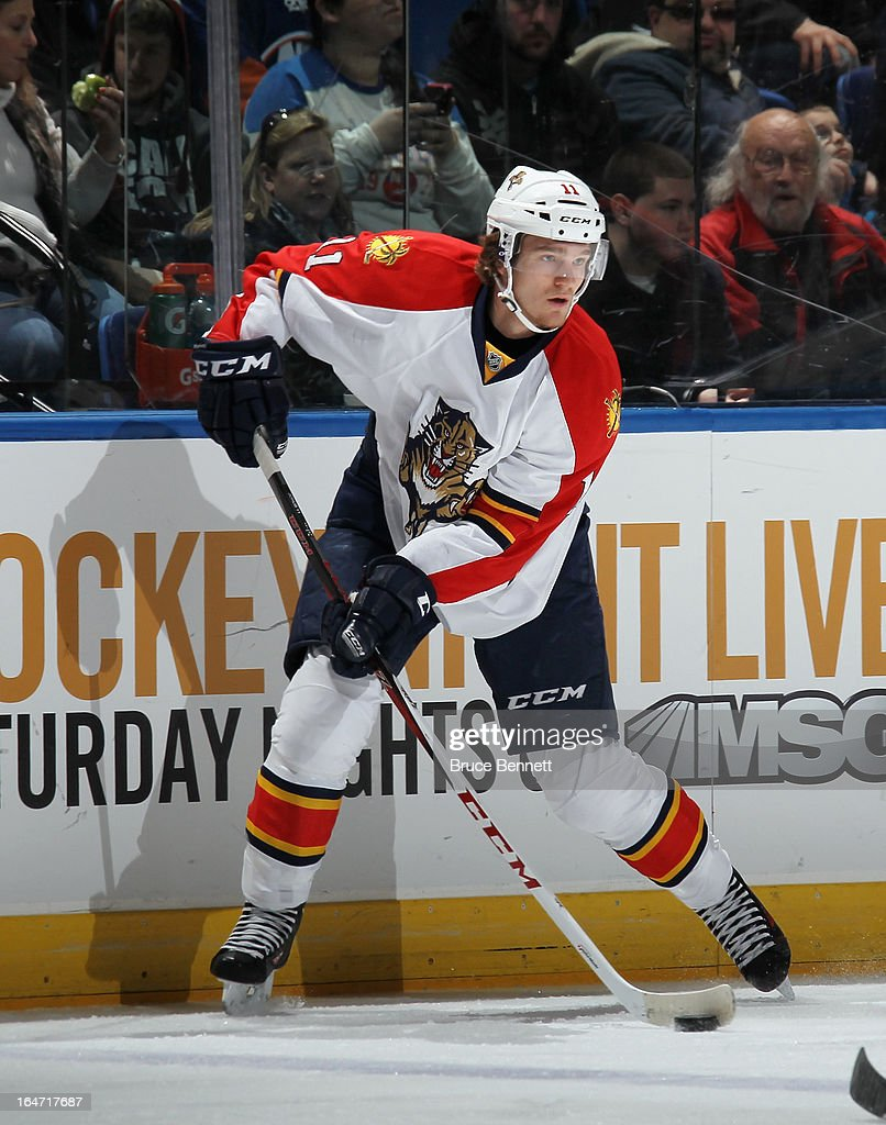 Jonathan Huberdeau #11 of the Florida Panthers skates against the New York Islanders at the Nassau Veterans Memorial Coliseum on March 24, 2013 in Uniondale, New York.