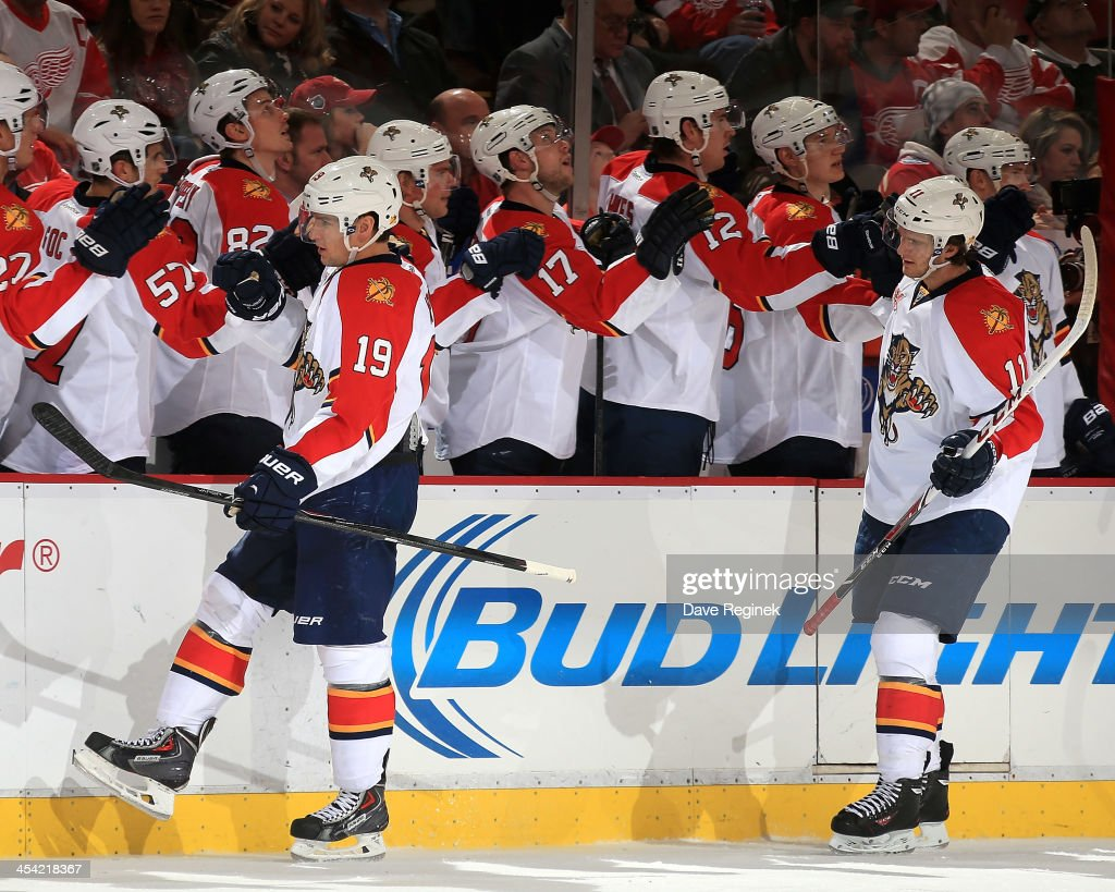 <a gi-track='captionPersonalityLinkClicked' href=/galleries/search?phrase=Jonathan+Huberdeau&family=editorial&specificpeople=7144196 ng-click='$event.stopPropagation()'>Jonathan Huberdeau</a> #11 of the Florida Panthers skates by his bench with teammate <a gi-track='captionPersonalityLinkClicked' href=/galleries/search?phrase=Scottie+Upshall&family=editorial&specificpeople=209198 ng-click='$event.stopPropagation()'>Scottie Upshall</a> #19 after scoring a goal during an NHL game against the Detroit Red Wings at Joe Louis Arena on December 7, 2013 in Detroit, Michigan.