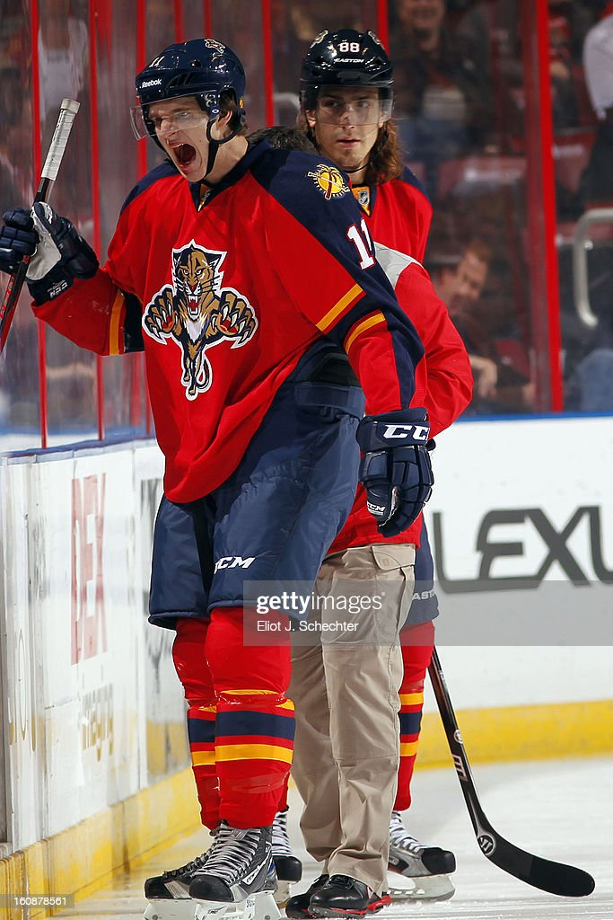 Jonathan Huberdeau #11 of the Florida Panthers skates off the ice with a bloodied mouth against the Winnipeg Jets at the BB&T Center on January 31, 2013 in Sunrise, Florida.