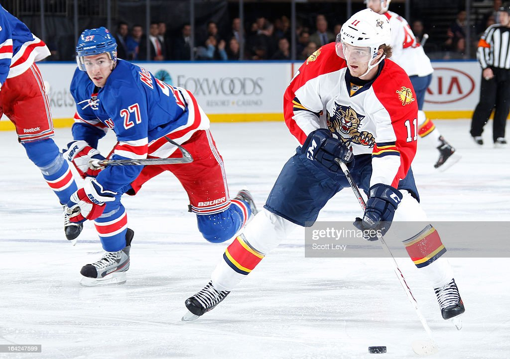 Jonathan Huberdeau #11 of the Florida Panthers skates past Ryan McDonagh #27 of the New York Rangers with the puck at Madison Square Garden on March 21, 2013 in New York City.