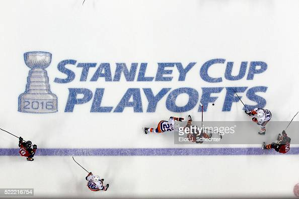 Jonathan Huberdeau of the Florida Panthers skates with the puck against Cal Clutterbuck and teammate Brock Nelson of the New York Islanders in Game...