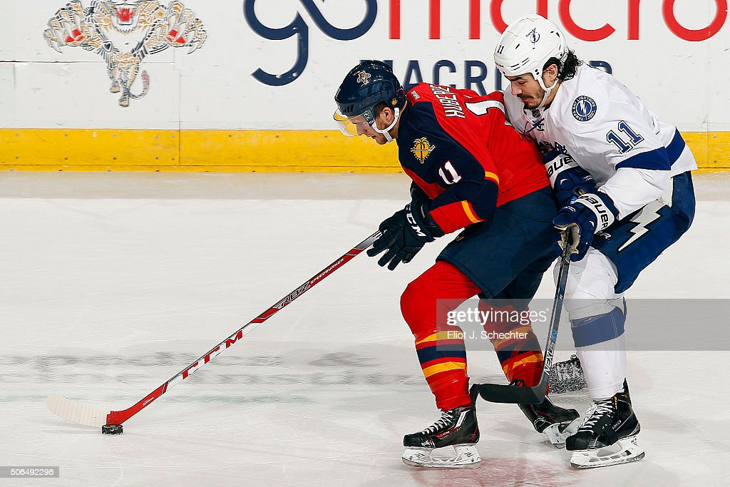 <a gi-track='captionPersonalityLinkClicked' href=/galleries/search?phrase=Jonathan+Huberdeau&family=editorial&specificpeople=7144196 ng-click='$event.stopPropagation()'>Jonathan Huberdeau</a> #11 of the Florida Panthers skates with the puck against <a gi-track='captionPersonalityLinkClicked' href=/galleries/search?phrase=Brian+Boyle+-+Hockey+sur+glace&family=editorial&specificpeople=8986264 ng-click='$event.stopPropagation()'>Brian Boyle</a> #11 of the Tampa Bay Lightning at the BB&T Center on January 23, 2016 in Sunrise, Florida.