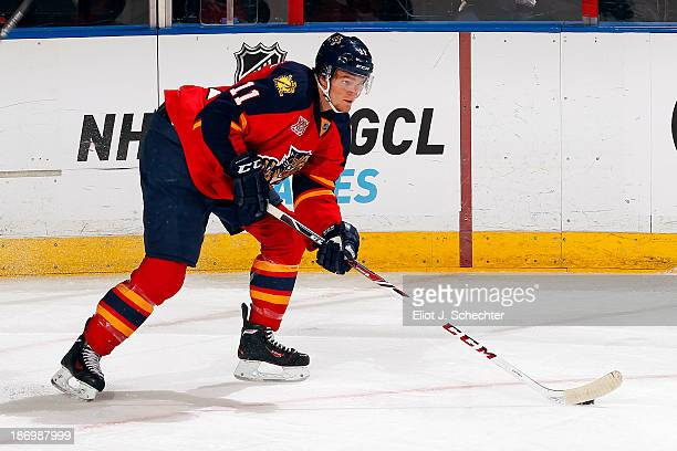 Jonathan Huberdeau of the Florida Panthers skates with the puck against the St Louis Blues at the BBT Center on November 1 2013 in Sunrise Florida