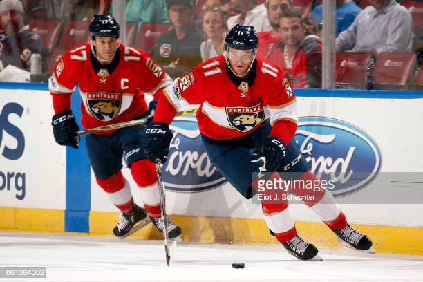 Jonathan Huberdeau of the Florida Panthers skates with the puck against the St Louis Blues at the BBT Center on October 12 2017 in Sunrise Florida