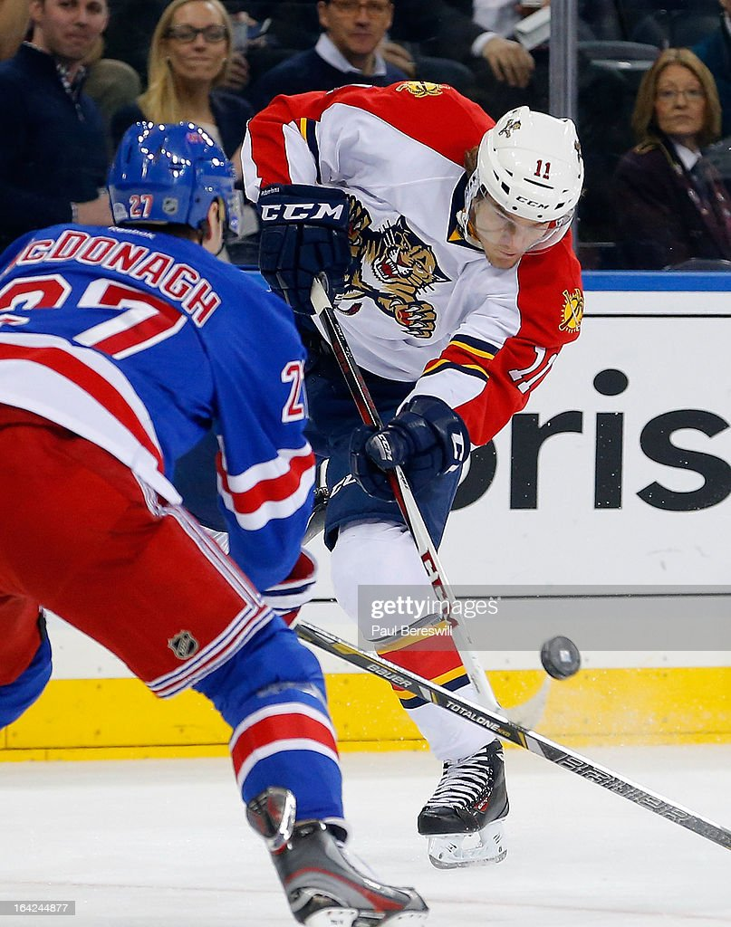 Jonathan Huberdeau #11 of the Florida Panthers takes a shot at goal past Ryan McDonagh #27 of the New York Rangers in the first period during an NHL hockey game at Madison Square Garden on March 21, 2013 in New York City.