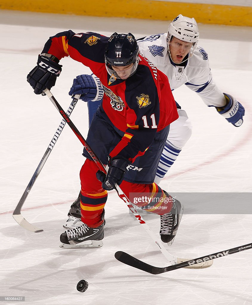 Jonathan Huberdeau #11 of the Florida Panthers tangles with Carl Gunnarsson #36 of the Toronto Maple Leafs at the BB&T Center on February 18, 2013 in Sunrise, Florida.