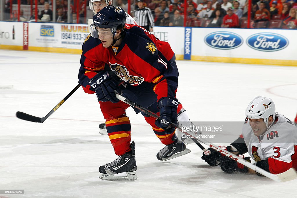 <a gi-track='captionPersonalityLinkClicked' href=/galleries/search?phrase=Jonathan+Huberdeau&family=editorial&specificpeople=7144196 ng-click='$event.stopPropagation()'>Jonathan Huberdeau</a> #11 of the Florida Panthers tangles with <a gi-track='captionPersonalityLinkClicked' href=/galleries/search?phrase=Marc+Methot&family=editorial&specificpeople=2216900 ng-click='$event.stopPropagation()'>Marc Methot</a> #3 of the Ottawa Senators at the BB&T Center on January 24, 2013 in Sunrise, Florida.