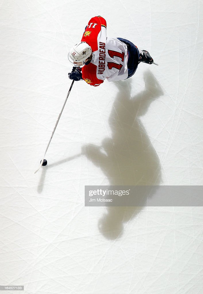 <a gi-track='captionPersonalityLinkClicked' href=/galleries/search?phrase=Jonathan+Huberdeau&family=editorial&specificpeople=7144196 ng-click='$event.stopPropagation()'>Jonathan Huberdeau</a> #11 of the Florida Panthers warms up before a game against the New Jersey Devils at the Prudential Center on March 23, 2013 in Newark, New Jersey. The Devils defeated the Panthers 2-1.