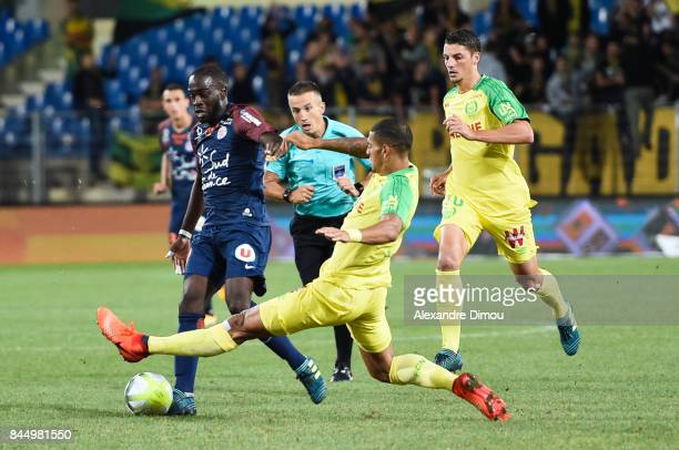 Jonathan Ikone of Montpellier and Diego Carlos Santos Silva of Nantes during the Ligue 1 match between Montpellier Herault SC and Nantes at Stade de...